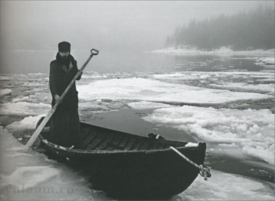 A monk boating in winter